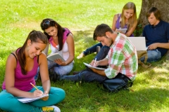 photodune-3162971-students-sitting-in-park-studying-reading-writing-m